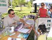 Donald Ratcliff, FWS, and Kari Burr, Fishery Foundation of CA,  at FLCR booth during Earth Day '09